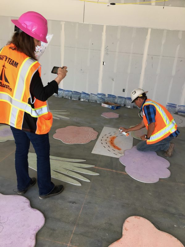 Artist works with Stone Finish's Lead Foreman Andy, to place terrazzo forms onsite at T3