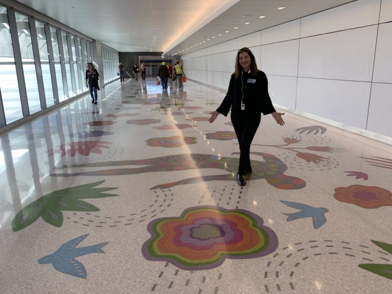 Artist standing on her finished terrazzo floor design